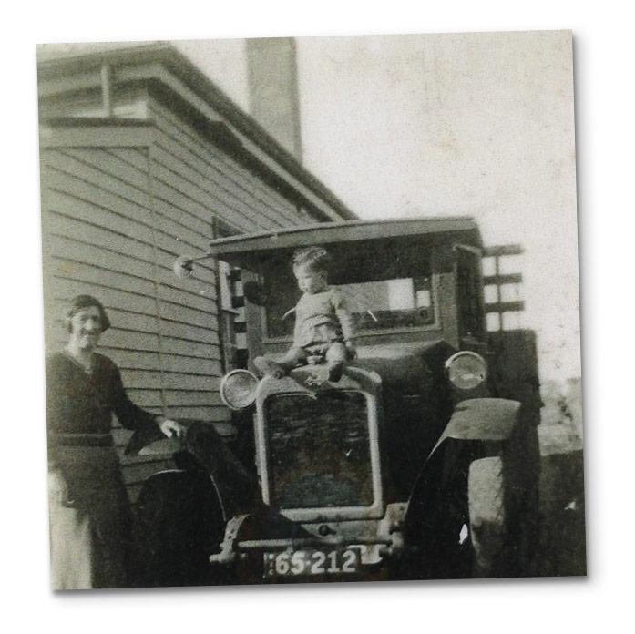 boy-sitting-on-car-shad
